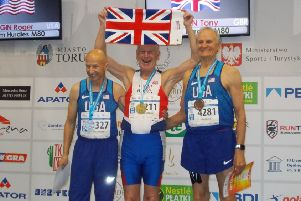 Tony Bowman, centre, with his gold medal.