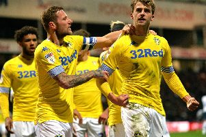 WHAT YOU SAYING?: Leeds United striker Patrick Bamford is congratulated by skipper Liam Cooper after his stunning opener in Tuesday night's 2-0 win at Preston North End. Picture by Bruce Rollinson.