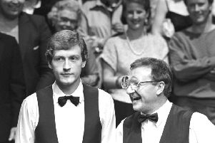 Dennis Taylor (right) and Steve Davis at the end of the World Snooker Championship final at the Crucible in 1985. Photo: PA/PA Wire.