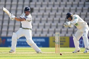 Gary Ballance of Yorkshire hits out as wicketkeeper Lewis McManus of Hampshire looks on during the Specsavers County Championship Division One match between Hampshire and Yorkshire at Ageas Bowl. (Picture: Mike Hewitt/Getty Images)