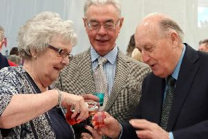 Just a little! Joan Moses offers Sir John a sample of her plum brandy.Picture by Jane Coltman