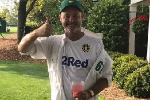 Caddie Billy Foster sporting his Leeds United colours at the Masters.