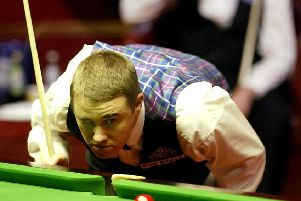 Scotland's Stephen Hendry at the table during his semi-final match against Ronnie O'Sullivan (background) in The 2004 Embassy World Snooker Championships at The Crucible Theatre, Sheffield (Picture: Gareth Copley/PA)