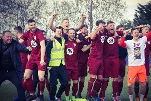 Tigers celebrate clinching the title after a 4-0 win on Saturday