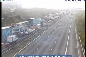 Traffic held on the M62 near Rothwell due to a pedestrian on the carriageway