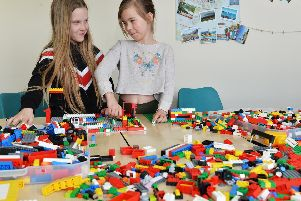 Cadence and Melissa playing with Lego at the LS14 Trust in Seacroft. Picture: Bruce Rollinson