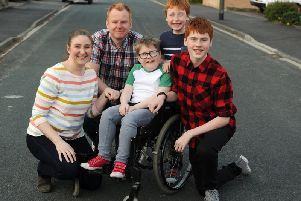 Alex and Warren Ashurst with ten-year-old Euan, who has progressive muscle wasting condition Duchenne muscular dystrophy, and brothers Rory and Luke.