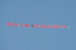 The man behind the banner flying over Elland Road this afternoon (Friday) says it is time to believe more than ever after the team's 2-1 loss to Wigan Athletic.