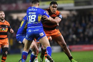 Leeds Rhinos' Nathaniel Peteru tackles Junior Moors of Castleford Tigers. Picture Jonathan Gawthorpe