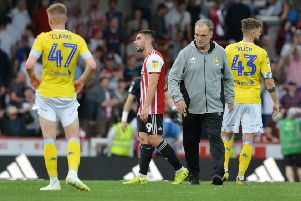Marcelo Bielsa and dejected Leeds United players at full-time. Picture: Bruce Rollinson
