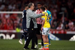 PAIN: Leeds United head coach Marcelo Bielsa goes to comfort a very upset Pablo Hernandez following Monday's 2-0 loss at Brentford.