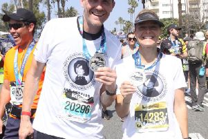 Brother and sister James and Lucy Ralph at the finish line of the Los Angeles marathon.