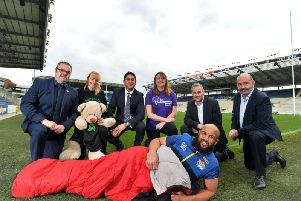 Leeds Rhinos star Jamie Jones-Buchanan beds down at today's Leeds Big Sleep launch at Emerald Headingley Stadium.