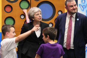 Prime Minister Theresa May and Pendle MP Andrew Stephenson chatting with two youngsters at the Leisure Box in Brierfield