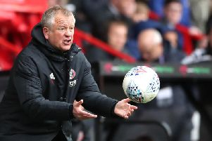 Chris Wilder launches the ball back onto the field during Sheffield United's win over Ipswich Town.