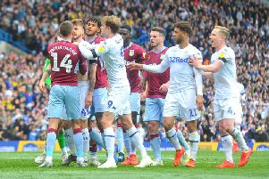 Leeds United and Aston Villa players clash following Mateusz Klich's opening goal.