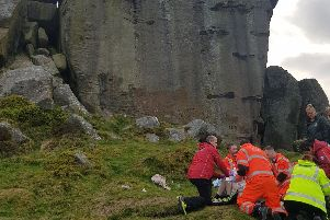 Paramedics and air ambulance attend to the man after he fell from the rocks (Photo: Sean Nicholl)