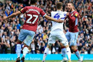 Mateusz Klich and Conor Hourihane clash after Leeds United's opening goal against Aston Villa at Elland Road.