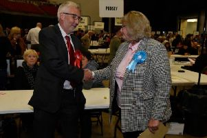 Richard Lewis congratulates Trish Smith after the Conservative defeated the Labour stalwart in the Pudsey ward.