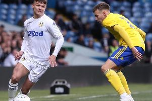 Leeds United's Jamie Shackleton runs at Birmingham City during today's U23s play-off final at Elland Road.