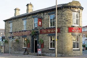 The Marsh pub, on Bradford Road in Cleckheaton, was the subject of a violent raid last night.