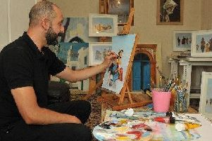 Mohammed Ehlalouch at work at his easel.
