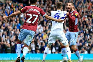 Leeds United and Aston Villa clash after controversial goal at Elland Road.