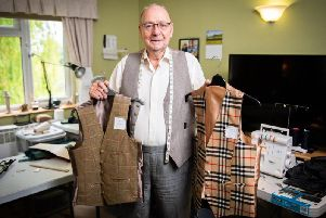 Elwyn Hughes is thought to be the oldest working tailor in the UK.