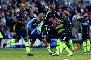Manchester City's Vincent Kompany (left) celebrates winning the Premier League title at the AMEX Stadium. Picture: Gareth Fuller/PA