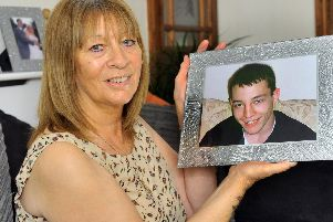 Leeds mum Anne Cameron with picture of son Ricky, who died in 2009 from a brain haemorrhage