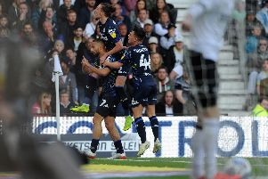 Leeds United celebrate Kemar Roofe's opening goal at Pride Park against Derby County.