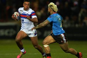 Junior Sa'u moves in to tackle Reece Lyne when Salford faced Wakefield last season. Picture  Bruce Rollinson