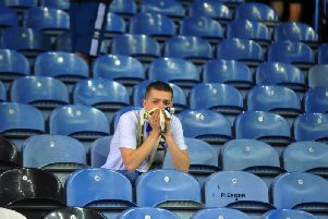A Leeds United fan looks on at Elland Road.