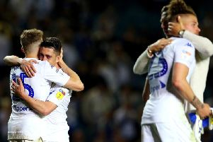 Leeds United players embrace at full-time.