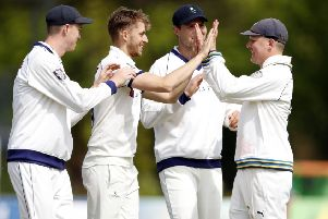 Ben Coad (2nd L) of Yorkshire enjoys a high five with Gary Ballance after taking the wicket of Ollie Robinson.