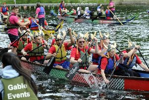 Action at a previous Dragon Boat Race on the lake at Roundhay Park.