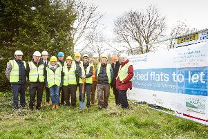 Members of Winster Parish Council and project partners mark the start of work on a development of four new affordable flats in the village.