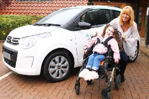 Christine Talbot launches the Martin House car raffle with the help of Lacie-Lea Rennie.