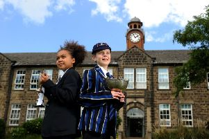 Prince Henrys Grammar School, Otley, celebrates 100 years. Pictured in the old and new uniforms are Martha Thornton aged 12 and Jack Hartis aged 12.