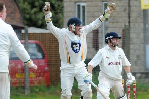 Pudsey St Lawrence wicketkeeper Charlie Best celebrates stumping Woodlands opener Tim Jackson during Saturday's Bradford Premier League clash. Picture: Steve Riding