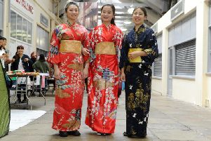 Leeds University students Helena da Costa, Louisa Luong and Mia Huffman dress in traditional Japanese kimono's at the third Sakura Japanese Cultural Festival, a special pop-up experience in Leeds Market on 8 June 2019.