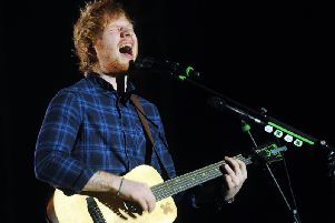 Ed Sheeran tops the list of most-played songs on the radio last year.