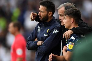 KEY INFLUENCE: Carlos Corberan and Marcelo Bielsa with Jamie Shackleton as the midfielder gets ready to make his Leeds United debut in August's 4-1 win at Derby County.