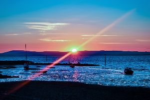Sunset in Morecambe by Daniel Coxhill.