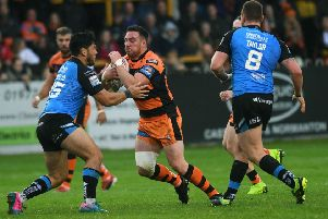Grant Millington is tackled by Hull's Andre Savelio.