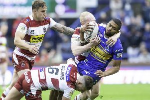 On his way:  Leeds Rhinos star Kallum Watkins is tackled by Wigan's George WIlliams and Liam Farrell. Picture: Allan McKenzie/SWpix
