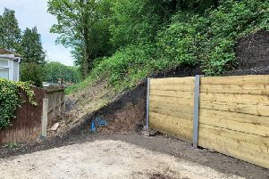 Residents with concerns about the new retaining wall are advised to contact the HSE