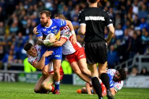 LOOKING UP: Leeds Rhinos' Adam Cuthbertson is tackled to the ground against Hull KR. Picture: James Hardisty.