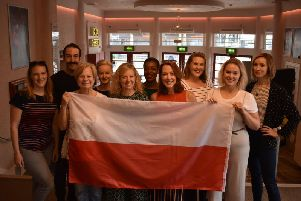 The cast of the play flying the Polish flag