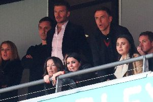 CLASS OF 92: Salford City co-owners Gary Neville, David Beckham and Phil Neville watch their side beat AFC Fylde in the National League play-off final. Now Salford will take on Leeds United in the Carabao Cup.